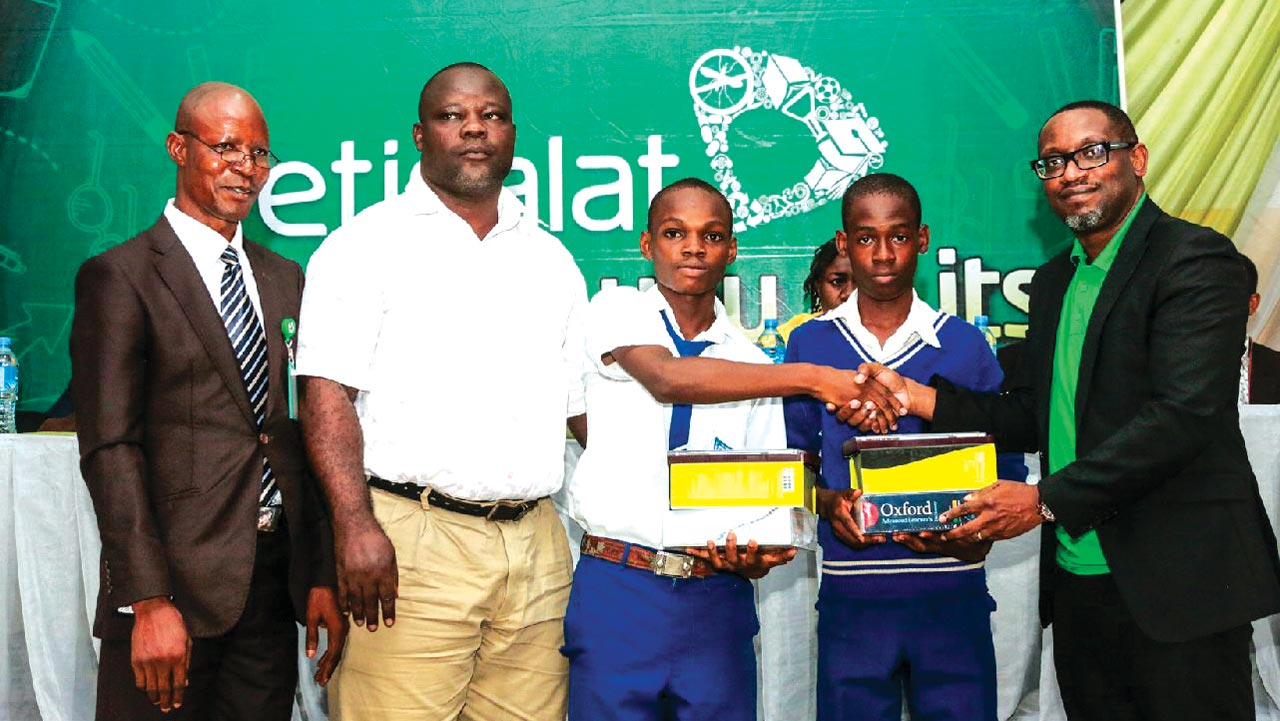 Deputy Director, Education District 3, Lagos State Ministry of Education, Ojikutu Mustafa (left); Teacher, Epe Senior Grammar School, Epe, Olusanya Ganiyu; prize winners of Epe Senior Grammar School, Denis Akpan and Seyi Awofiranye receiving their prizes from Director, Regulatory & CSR, Etisalat Nigeria, Ikenna Ikeme at the event Deputy Director, Education District 3, Lagos State Ministry of Education, Ojikutu Mustafa (left); Teacher, Epe Senior Grammar School, Epe, Olusanya Ganiyu; prize winners of Epe Senior Grammar School, Denis Akpan and Seyi Awofiranye receiving their prizes from Director, Regulatory & CSR, Etisalat Nigeria, Ikenna Ikeme at the event