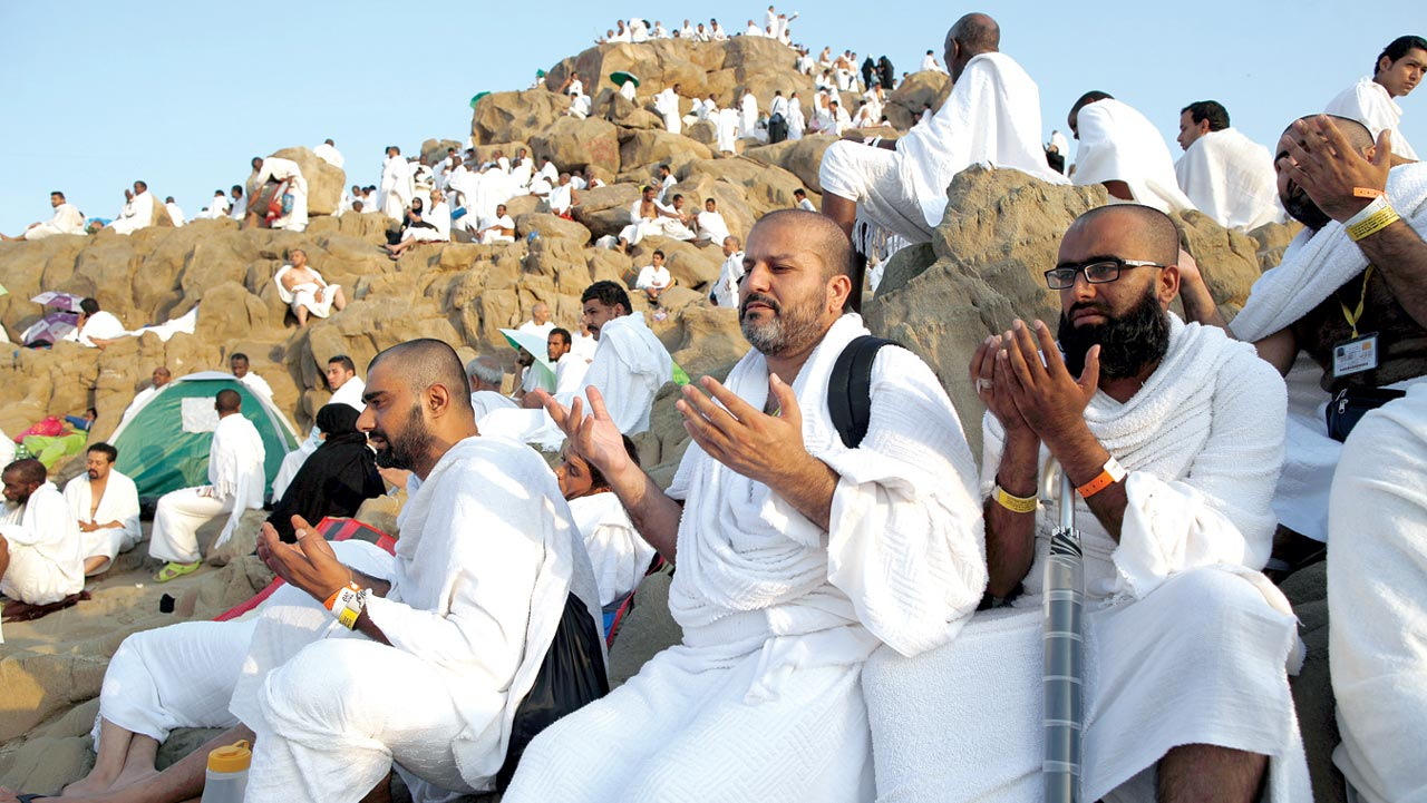 Muslim pilgrims join one of the Hajj rituals on Mount Arafat near Mecca early yesterday. Close to 1.5 million Muslims from around the world prepared on September 10 night for the climax of the annual hajj pilgrimage at a rocky hill known as Mount Arafat. The pilgrims will mark September 11 with day-long prayers and recitals of the Koran holy book at the spot in western Saudi Arabia where they believe their Prophet Mohammed gave his last hajj sermon. PHOTO:AHMAD GHARABLI / AFP