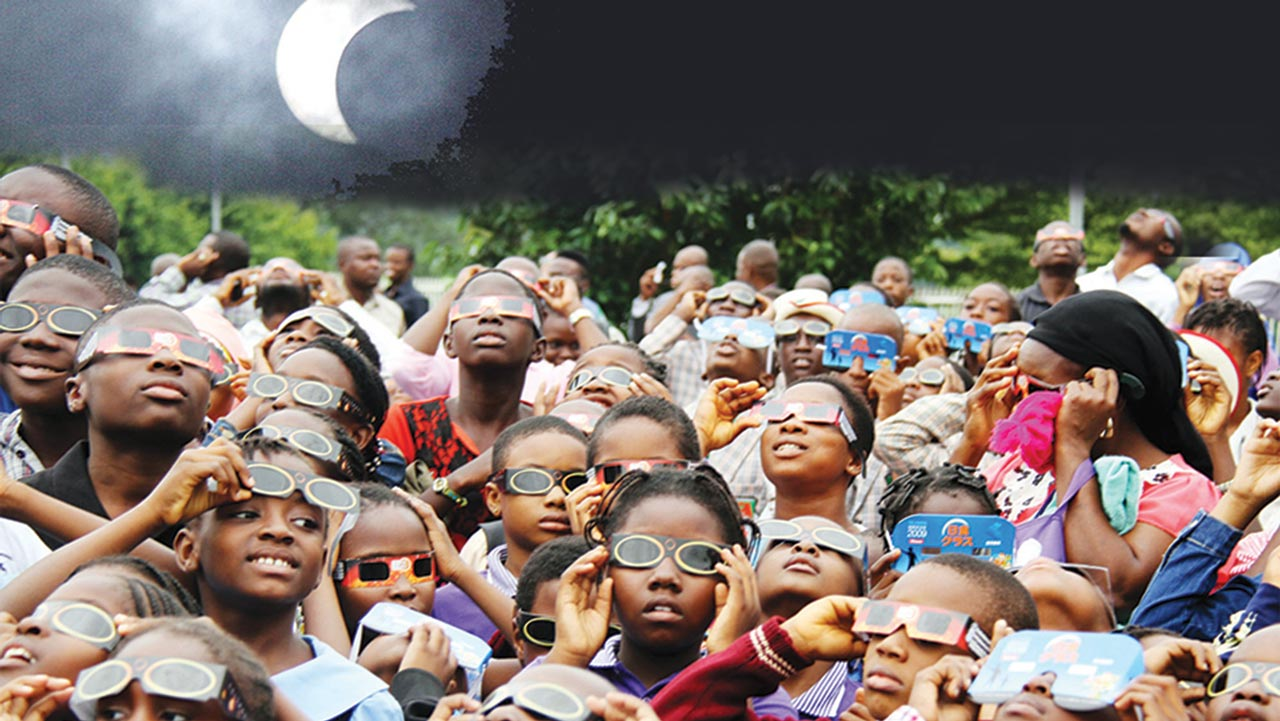 Students from various schools catching  a glimpse of the solar eclipse at National Space Research and Development Agency (NSRDA) in Abuja …yesterday PHOTOS: LUCY LADIDI ELUKPO