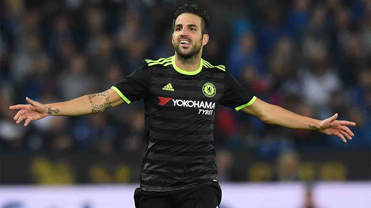 Chelsea's Spanish midfielder Cesc Fabregas celebrates scoring their fourth goal during extra-time in the English League Cup third round football match between Leicester City and Chelsea at King Power Stadium in Leicester, central England on September 20, 2016. / AFP PHOTO / Anthony DEVLIN / RESTRICTED TO EDITORIAL USE. No use with unauthorized audio, video, data, fixture lists, club/league logos or 'live' services. Online in-match use limited to 75 images, no video emulation. No use in betting, games or single club/league/player publications.  /