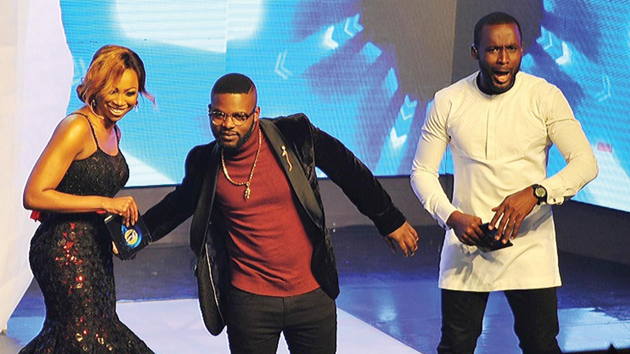 Rapper Falz (middle) with Project Fame hosts.