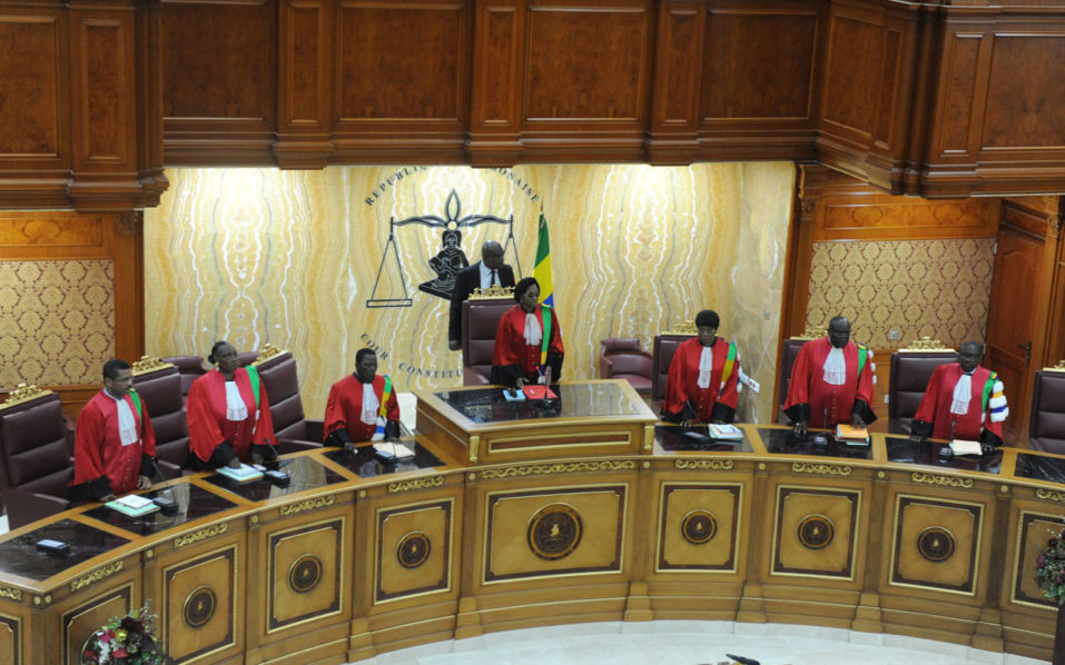 President of the Gabonese Constitutional Court Marie-Madeleine Mborantsuo (C) takes her seat ahead of a hearing at the Constitutional Court in Libreville on September 22, 2016. Gabon's constitutional court is to rule as early as Friday who will be the country's next president, ending weeks of uncertainty after disputed polls sparked a political crisis and violent protests. / AFP PHOTO / STEVE JORDAN