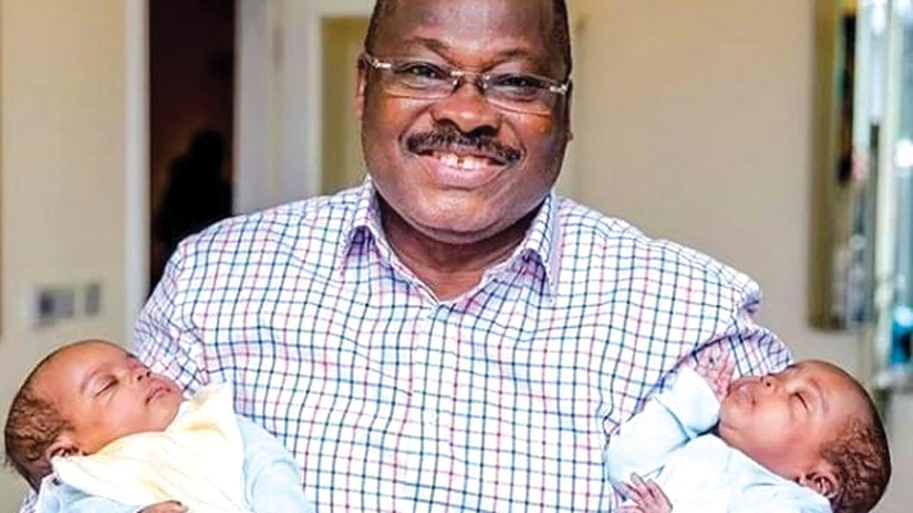 Governor-Abiola-Ajimobi-carrying-newly-born-twins