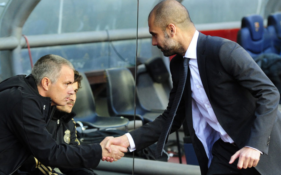 "(FILES) This file photo taken on April 21, 2012 shows Real Madrid's Portuguese coach Jose Mourinho (L) shaking hands with Barcelona's coach Josep Guardiola (R) during the Spanish League ""El clasico"" football match Barcelona vs Real Madrid at the Camp Nou stadium in Barcelona on April 21, 2012. Manchester United welcome Manchester City to Old Trafford on September 10, 2016 in a derby match that sees opposing managers Jose Mourinho and Pep Guardiola renew their sulphurous rivalry. / AFP PHOTO / JAVIER SORIANO"