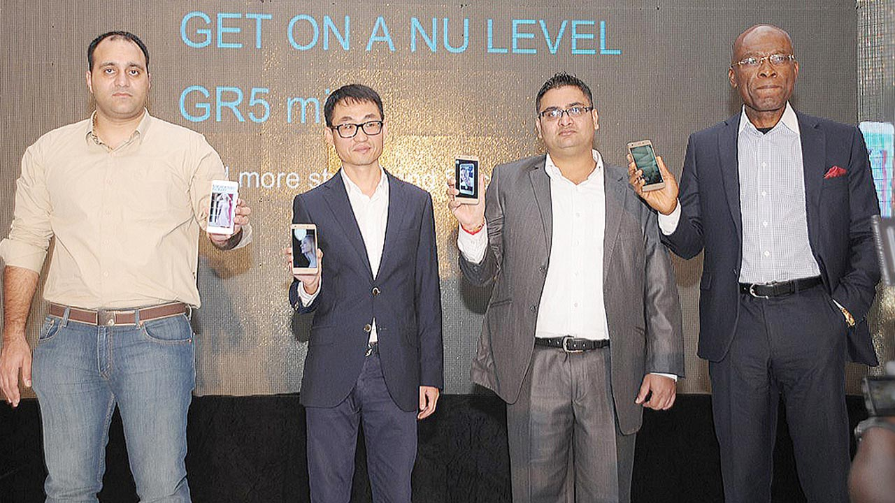 Channel Director, Consumer Business, Huawei Nigeria, Jason Zhou (left)); Managing Director, Consumer Marketing, Leo Jiang; Marketing Director, Consumer Business, Kyle Pan and the Chairman, Technology Distribution Limited, Leo Stan Ekeh, during the launch of Huawei's GR5 Mini smartphone in Lagos at the weekend.