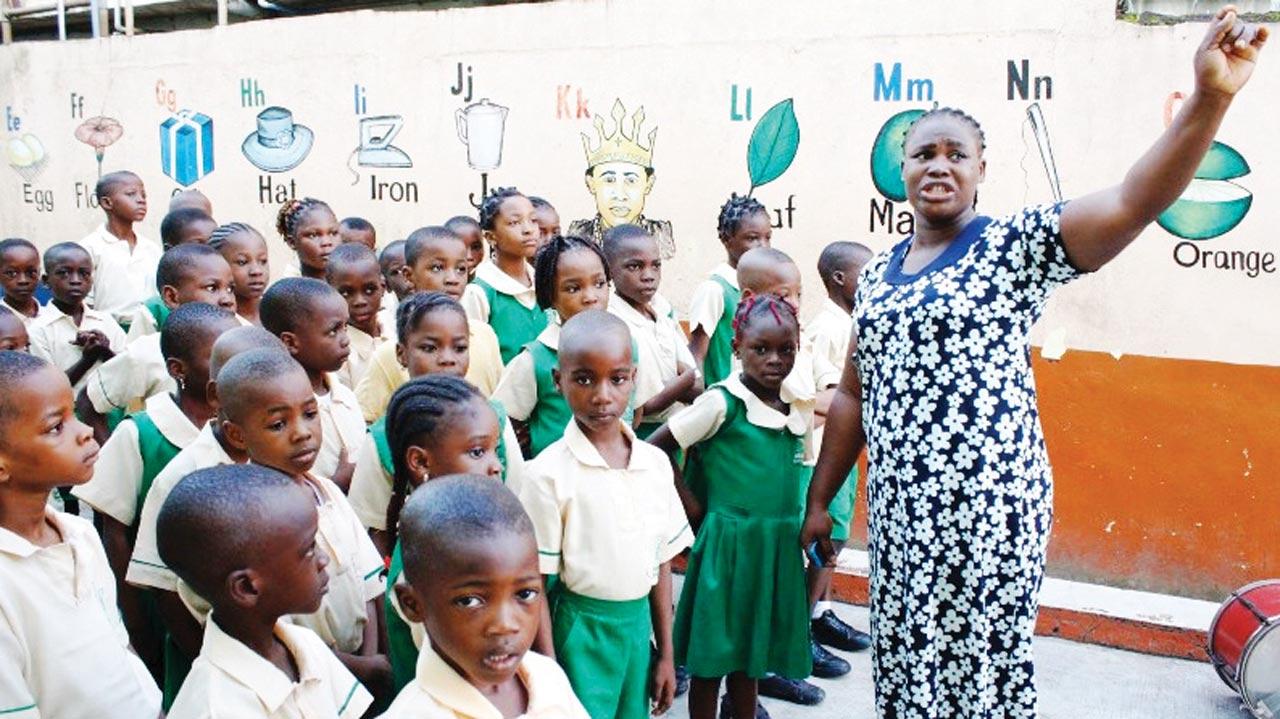 Pupils of Ibukunola Memorial Nursery/Primary School, Mafoluku-Oshodi, at the assembly ground during their resumption for the new academic session in Lagos... yesterday. PHOTO: FEMI ADEBESIN-KUTI