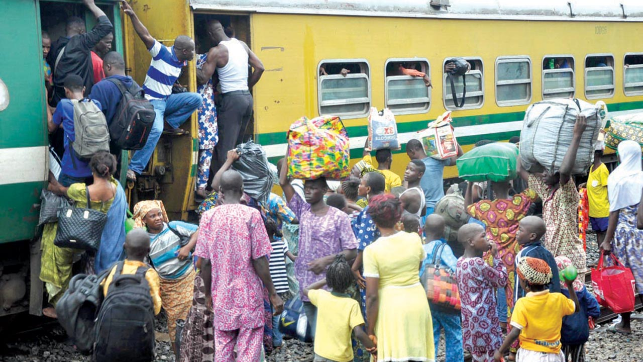 Indigenes of Osun State boarding a train to celebrate the Ileya Festival, in Osogbo, from the Iddo Terminus. The free ride is at the instance of the Rauf-Aregbesola-led government.     PHOTO: GABRIEL IKHAHON