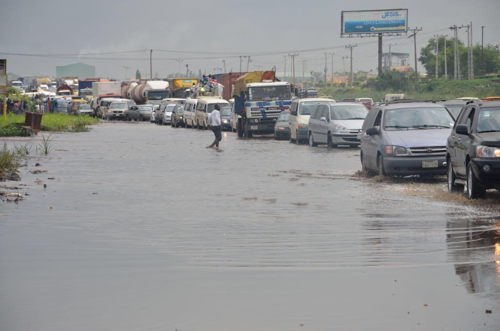 A portion of Lagos-Ibadan Expressway flooded on Saturday. PHOTO: BUNMI AMOSU