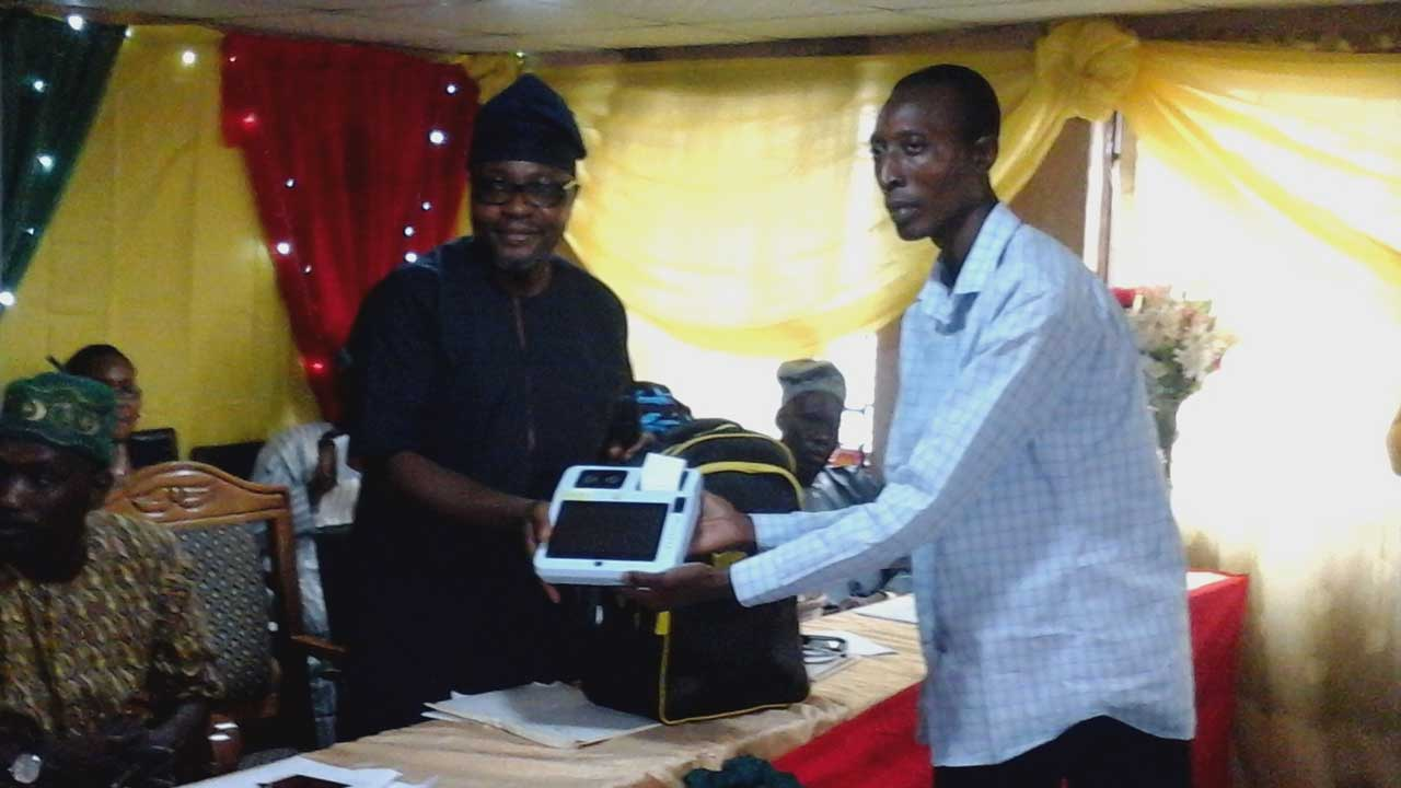 Sole Administrator, Lagos Island East Local Council Development Area (LCDA), Ajele, Lagos, Mr. Abiola Bashir Are, presenting working tools to one of the beneficiaries of the Unemployed Graduates Empowerment programme, last week.