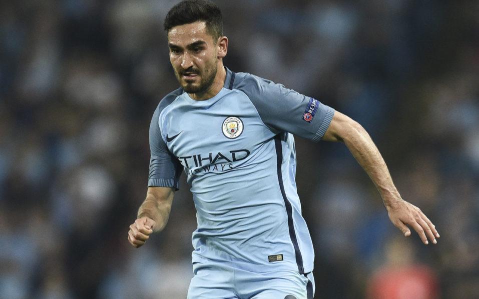 Manchester City's German midfielder Ilkay Gundogan/ AFP PHOTO / OLI SCARFF