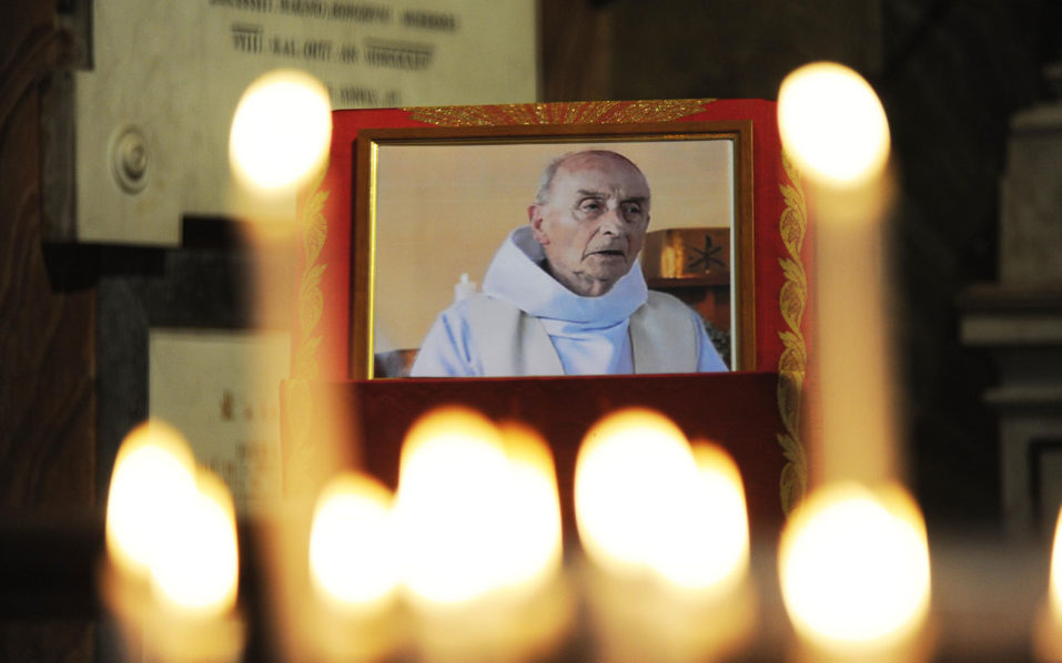 (FILES) This file photo taken on August 17, 2016 shows a picture of slain Father Jacques Hamel displayed inside the church of San Luigi dei Francesi in downtown Rome. Pope Francis will celebrate mass on September 14, 2016 in honour of Jacques Hamel, the French priest who died in July after having his throat slit by Islamist militants. Around 80 pilgrims from the diocese of Rouen in northern France will attend the early morning service in the chapel at St Martha's, the boarding house where Francis stays.  / AFP PHOTO / MARCO ZEPPETELLA