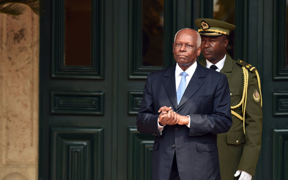 "(FILES) This file photo taken on July 3, 2015 shows Angola President Jose Eduardo Dos Santos waiting for the arrival of his French counterpart at the presidential palace in Luanda.  Will he go, will he stay? Angola's President Jose Eduardo dos Santos last week began his 38th year of largely unchallenged rule after promising to step down in 2018. ""I have decided to leave political life in 2018,"" the 74-year-old leader told party officials of his People's Movement for the Liberation of Angola (MPLA) in a surprise announcement in March, while giving no reason for the decision. But last month, dos Santos was re-elected head of the MPLA, which would automatically extend his mandate as Angola's ruler by five years if the party wins an election in 2017, as expected / AFP PHOTO / ALAIN JOCARD"