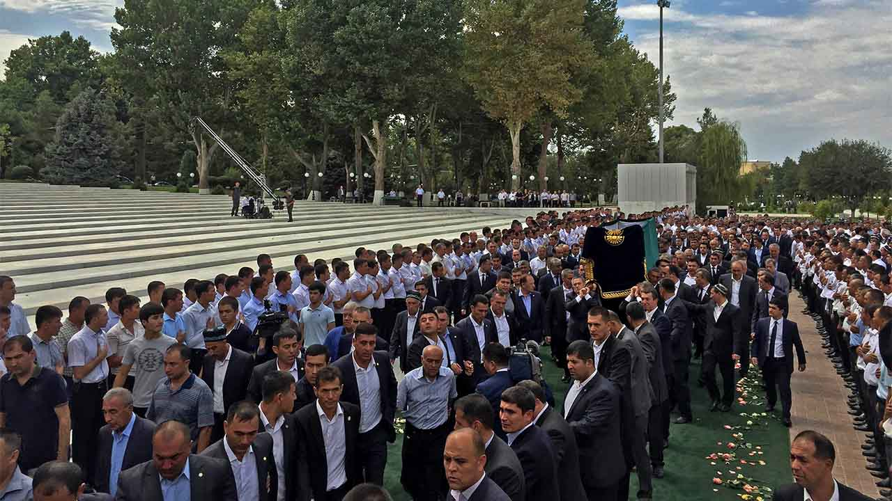 "People attend the funeral ceremony of the late Uzbek President Islam Karimov at Samarkand's Registan square on September 3, 2016. Uzbekistan laid strongman President Islam Karimov to rest on September 3 amid tight security, after his death triggered the deepest period of uncertainty in the country's post-Soviet history with no clear successor in view. Karimov, 78, was pronounced dead late Friday after suffering a stroke last weekend and falling into a coma, authorities said, following days of speculation about his rapidly failing health.  / AFP PHOTO / HO / RESTRICTED TO EDITORIAL USE - MANDATORY CREDIT ""AFP PHOTO / Kyrgyzstan Government Press Service  - NO MARKETING NO ADVERTISING CAMPAIGNS - DISTRIBUTED AS A SERVICE TO CLIENTS"