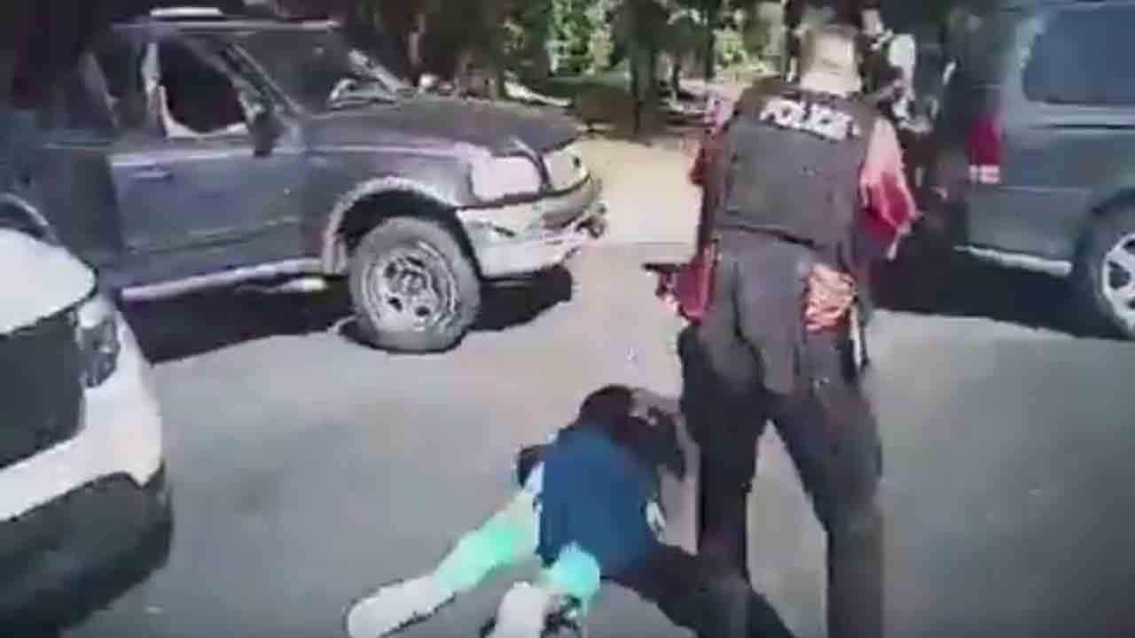 "This police body camera screen grab courtesy of a Charlotte-Mecklenburg Police Department  video released on September 24, 2016, shows Keith Lamont Scott (L) lying on the ground after being shot as as a police officer approaches in Charlotte, North Carolina on September 20, 2016. Charlotte police have released footage of the shooting death of a Scott during an encounter with officers in the state of North Carolina, after days of protests demanding the videos be made public.Scott was shot and killed at a Charlotte apartment complex during an encounter with police searching for another person wanted for arrest. Police say he had a handgun. His family says he was holding a book.  / AFP PHOTO / Charlotte-Mecklenburg Police Department / HO / RESTRICTED TO EDITORIAL USE - MANDATORY CREDIT ""AFP PHOTO / Charlotte-Mecklenburg Police Department "" - NO MARKETING NO ADVERTISING CAMPAIGNS - DISTRIBUTED AS A SERVICE TO CLIENTS"