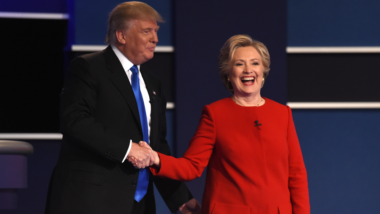 Democratic nominee Hillary Clinton (R) shakes hands with Republican nominee Donald Trump after the first presidential debate at Hofstra University in Hempstead, New York on September 26, 2016. PHOTO: AFP / Timothy A. CLARY