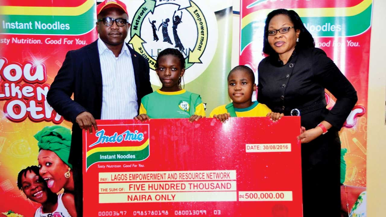 From left, Group Public Relations and Events Manager, Dufil Prima Foods Plc, Tope Ashiwaju; Priscilla Oboh and Ekuma Kennedy, both students of the Lagos Empowerment and Resources Network (LEARN), and Project Manager, LEARN, Bisi Awoyomi, at the donation in support of LEARN by Dufil Prima Foods Plc in Lagos.