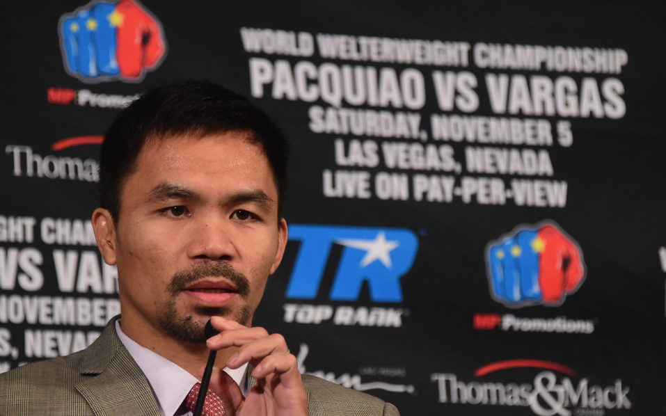 Boxer Manny Pacquiao speaks at a press conference with Jessie Vargas in Beverly Hills, California on September 8, 2016, announcing their November 5th fight. / AFP PHOTO / Frederic J. BROWN