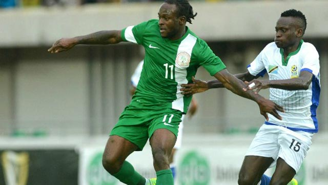 Super Eagles' Victor Moses (left) being challenged by a Tanzanian midfielder during their Gabon 2017 AFCON qualifier in Uyo. The Eagles will get jerseys for the 2016/2017 season… this week. PHOTO: AFP.