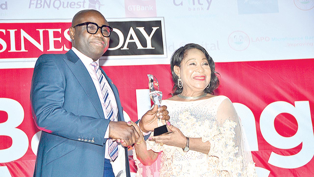 Divisional Head, Marketing & Corporate Relations, United Bank for Africa (UBA), Mr. Charles Aigbe, receiving the BUSINESSDAY award from the President, Lagos Chamber of Commerce and Industry (LCCI), Nike Akande, recently