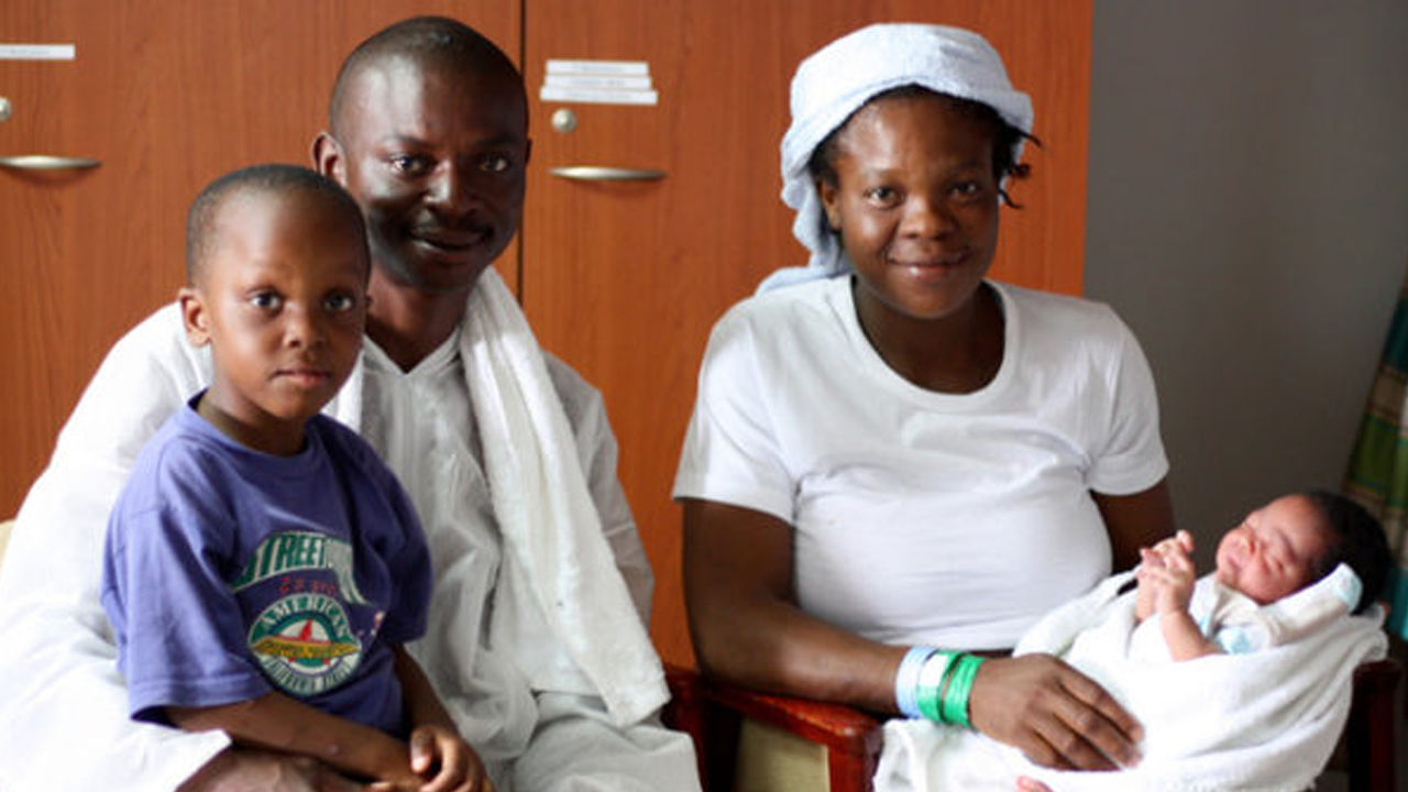 In this photo made available by MSF, Doctors Without Borders on Monday, Sept. 12, 2016, parents Otas, second left, and Faith, right, pose for a photo with one of their sons Rollres, left, and baby Newman Otas, born on board MV Aquarius, on the Mediterranean Sea. The family were rescued from an overcrowded rubber boat 24 hours previously. PHOTO: MSF/AP