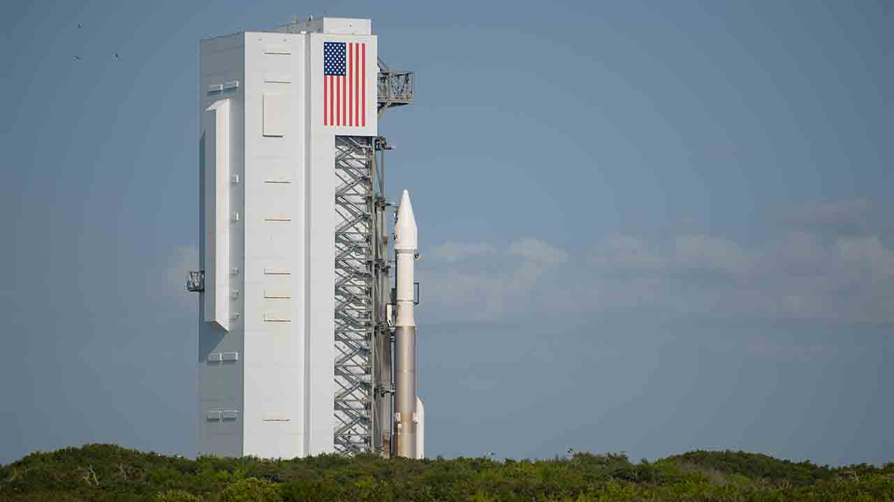"""The United Launch Alliance Atlas V rocket with NASA's Origins, Spectral Interpretation, Resource Identification, Security-Regolith Explorer (OSIRIS-REx) spacecraft on board is seen as it is roll out of the Vertical Integration Facility to Space Launch Complex 41 on September 7, 2016 at Cape Canaveral Air Force Station in Florida. OSIRIS-REx is scheduled to launch on September 8 from and will be the first US mission to sample an asteroid, retrieve at least two ounces of surface material and return it to Earth for study. The asteroid, Bennu, may hold clues to the origin of the solar system and the source of water and organic molecules found on Earth. / AFP PHOTO / nasa / Joel KOWSKY / RESTRICTED TO EDITORIAL USE - MANDATORY CREDIT """"AFP PHOTO / NASA/Joel Kowsky"""" - NO MARKETING - NO ADVERTISING CAMPAIGNS - DISTRIBUTED AS A SERVICE TO CLIENTS"""