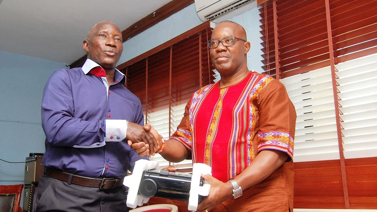 Vice Chancellor, Delta State University, Abraka, Prof. Victor Peretemode, (left) receiving the donation of educational materials from Prof. Nduka Otiono