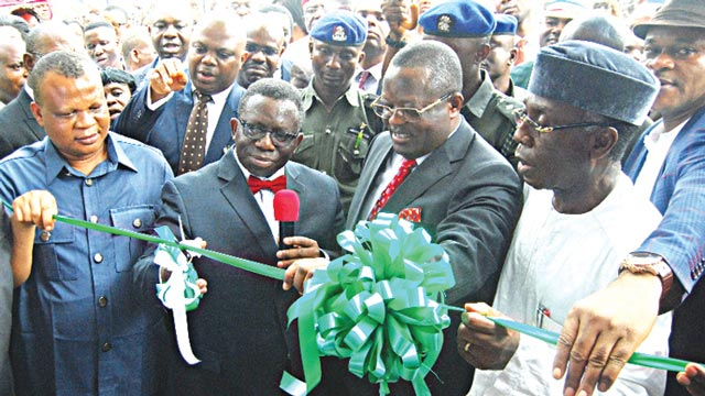 Minister of Agriculture and Rural Development, Chief Audu Ogbeh (right); Ebonyi State Governor David Umahi; Minister of Health, Prof. Isaac Adewole and the state Commissioner for Health, Dr. Daniel Umezuruike, at commissioning of the ultra-modern virology (lassa fever) centre built by the Ebonyi State government at the Federal Teaching Hospital, Abakaliki…yesterday.