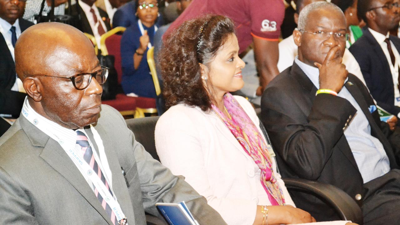 The Deputy Managing Director, Ibadan Electricity Distribution Company, John Oladipo (left), Chief Operation Officer, Eko DISCO, Mr. Sam Nwaire, Managing Director, TSPTCN, Tom Onyeka, at a forum on Power Nigeria Energising the Industry, organised by Informa Exhibition, in Lagos …yesterday. PHOTO: Gabriel Ikhahon