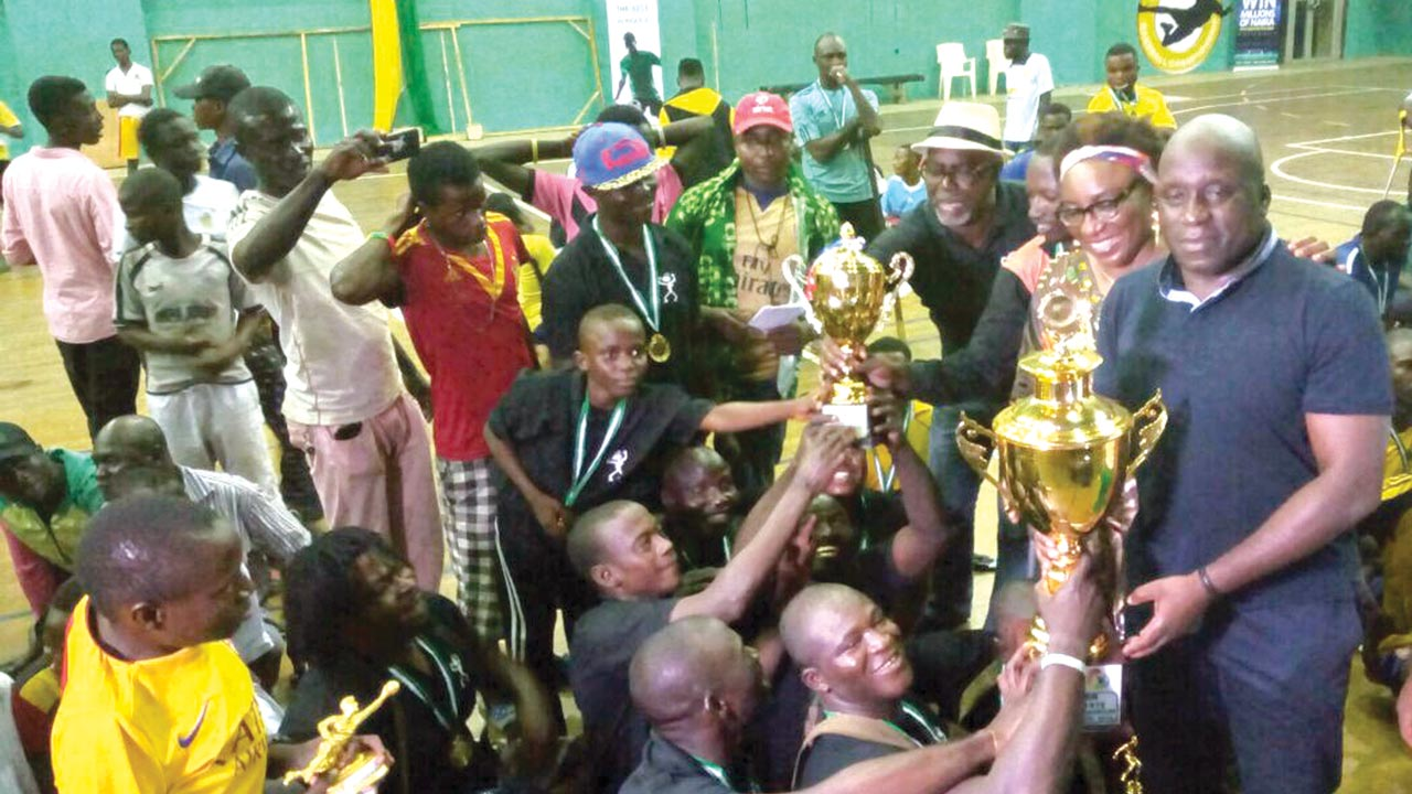 Special Adviser to the Governor of Lagos State on Sports, Mr. Deji Tinubu (right) celebrates with winners of the third edition of Lagos State Inter-Club Parasoccer Championship, TC Terror, at the Rowe Park Sports Complex, Yaba… at the weekend.