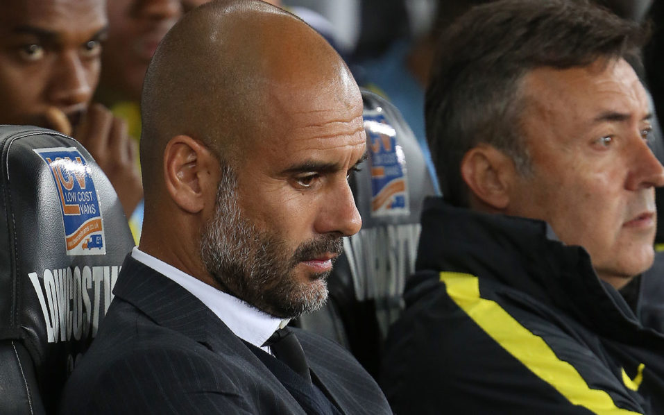 Manchester City's Spanish manager Pep Guardiola / AFP PHOTO / Geoff CADDICK /