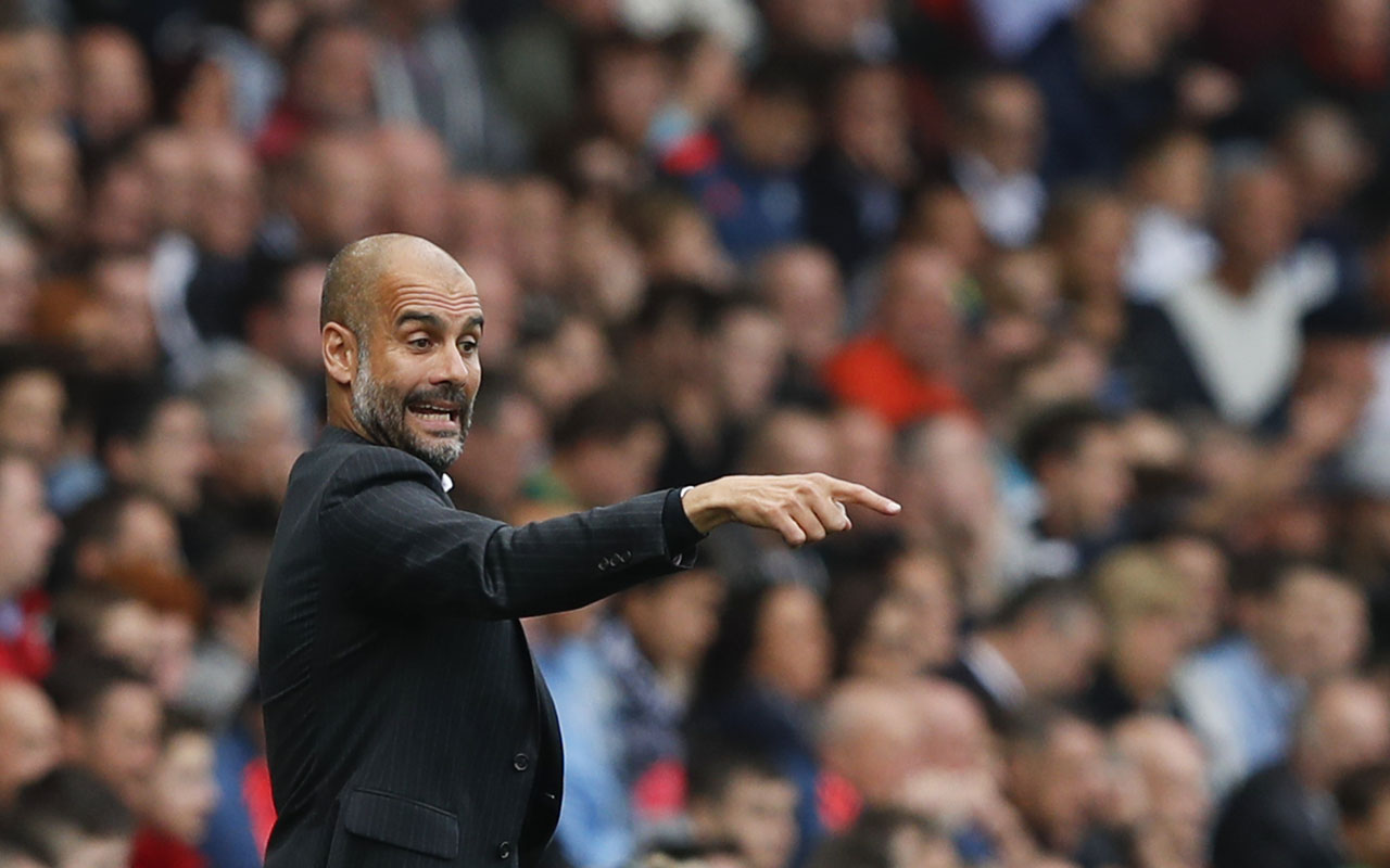 Manchester City's Spanish manager Pep Guardiola / AFP PHOTO / Adrian DENNIS /