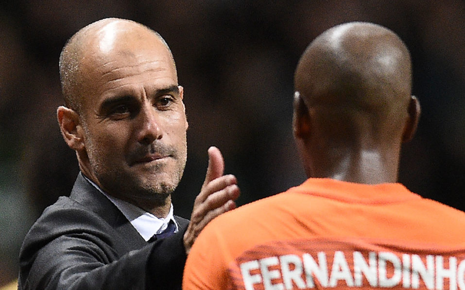 Manchester City's Spanish manager Pep Guardiola (L) congratulates Manchester City's Brazilian midfielder Fernandinho following the UEFA Champions League Group C football match between Celtic and Manchester City at Celtic Park stadium in Glasgow, Scotland on September 28, 2016. The match ended 3-3. / AFP PHOTO / OLI SCARFF