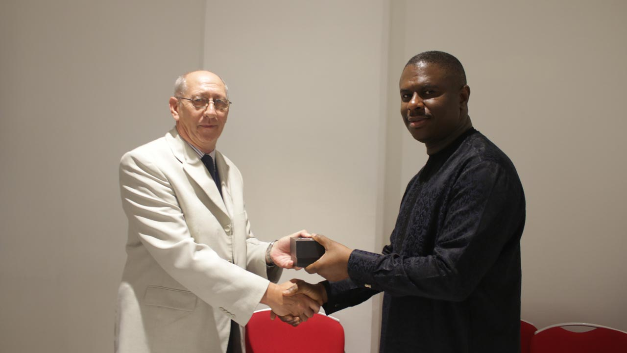 The Director General, Nigerian Maritime Administration and Safety Agency (NIMASA) Dakuku Peterside (right); presenting a souvenir to the Lead Consultant to the International Maritime Organisation (IMO) Brian Cranmer, during the closing ceremony of a five day training programme on ISPS Code compliance in Lagos.