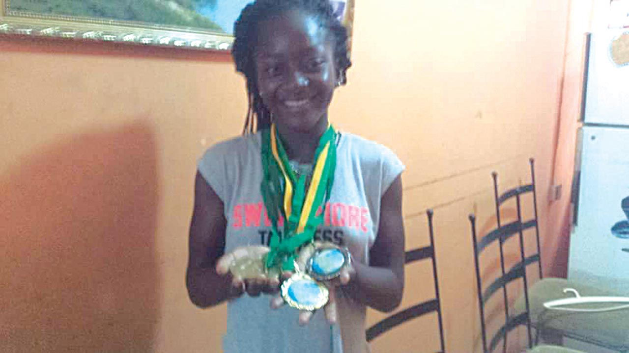 Oyinlomo Barakat Quadri displaying the medals she won at the just-concluded ITF West/Central Africa Junior Tennis Circuit.