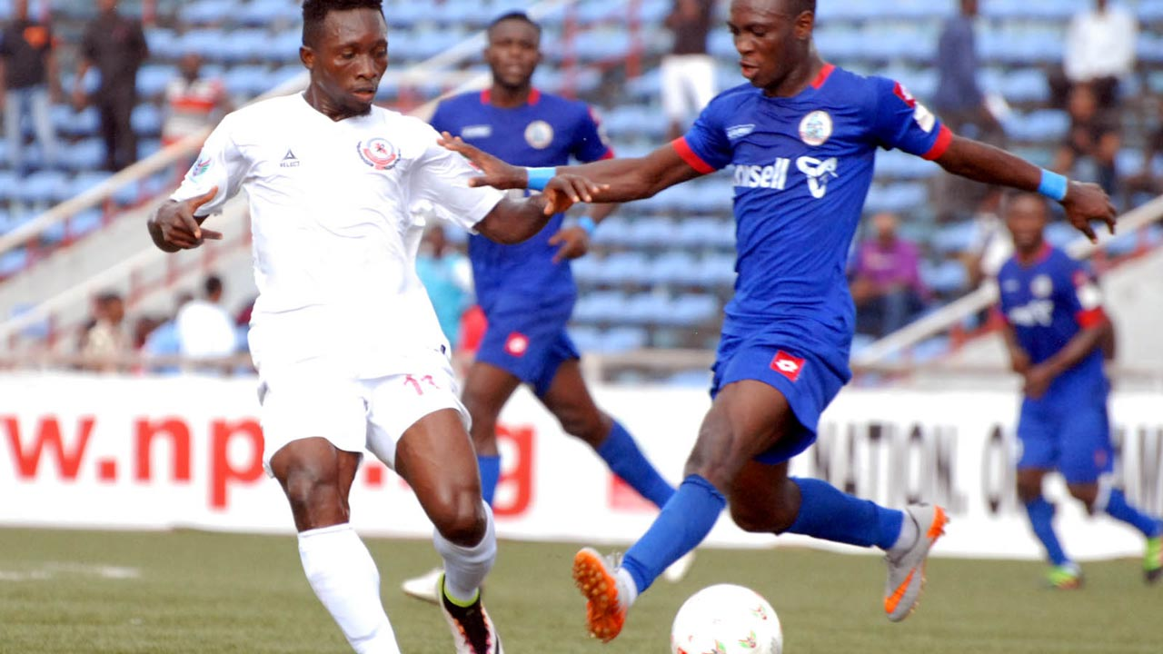 Chisom Egbuchulam of Enugu Rangers (left) challenges Rivers United's Bernard Ovoke during their NPFL game in Enugu… at the weekend. PHOTO: LMC.