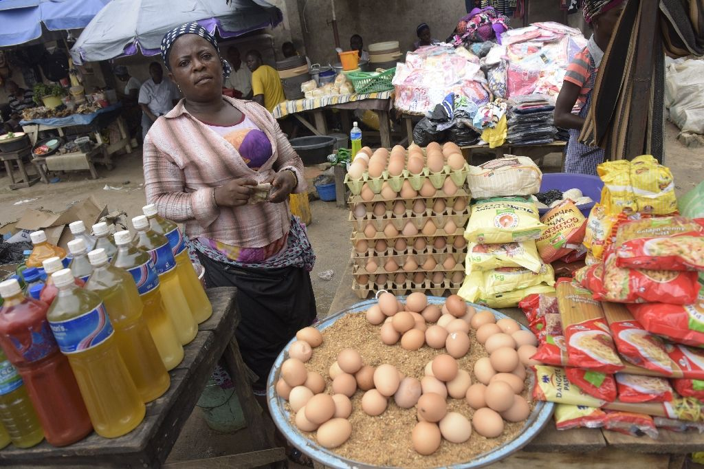 Ordinary Nigerians are feeling the full effects of spiralling inflation (AFP Photo/Pius Utomi Ekpei)