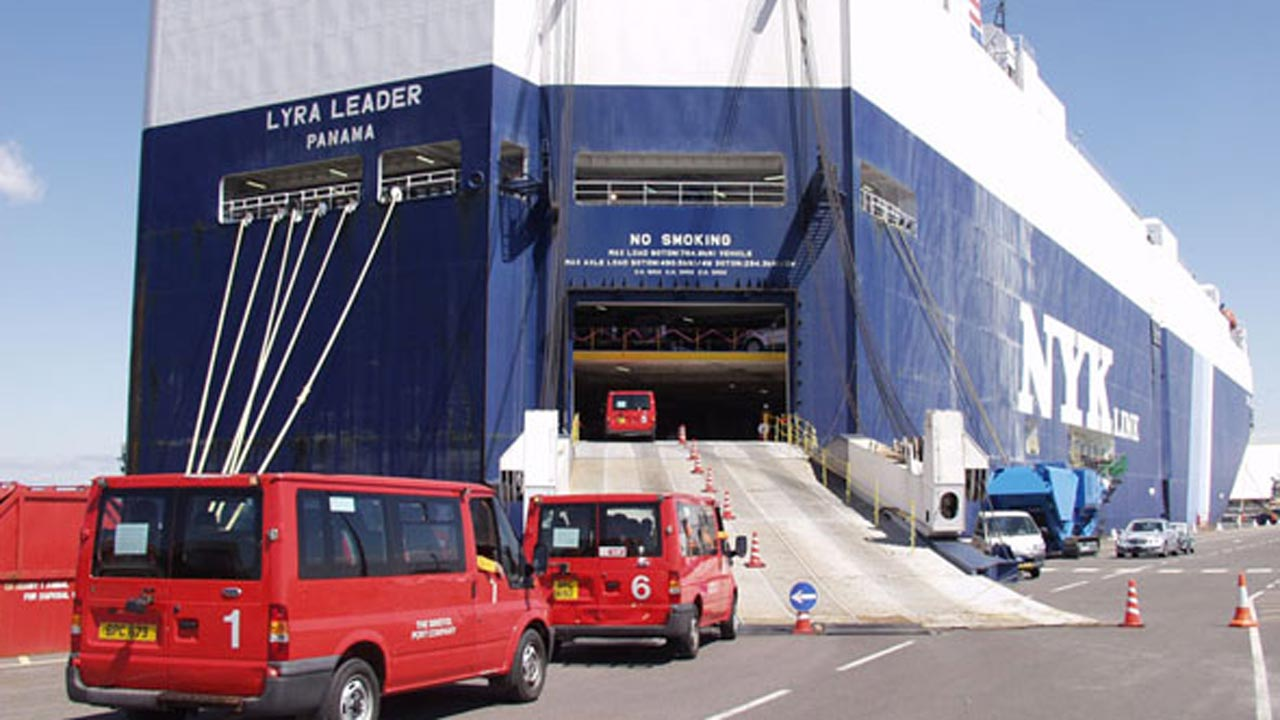 A RoRo vessel taking vehicles at the port.