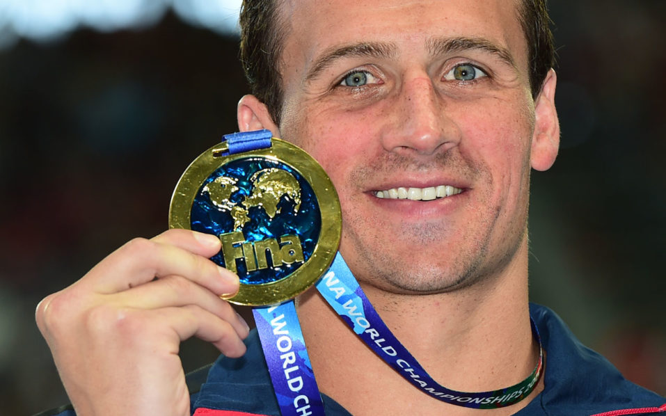 "(FILES) This file photo taken on August 6, 2015 shows USA's Ryan Lochte as he poses with his gold medal during the podium ceremony for  he men's 200m individual medley swimming event at the 2015 FINA World Championships in Kazan. US swimming star Ryan Lochte will look to turn the page after his drunken hijinks at the Rio Olympics cost him lucrative endorsements -- by appearing on the reality TV show ""Dancing with the Stars.""Lochte, 32, is among 13 celebrities to sign up for the popular television show, which launches its newest season on September 12, US network ABC confirmed Tuesday.  / AFP PHOTO / CHRISTOPHE SIMON"