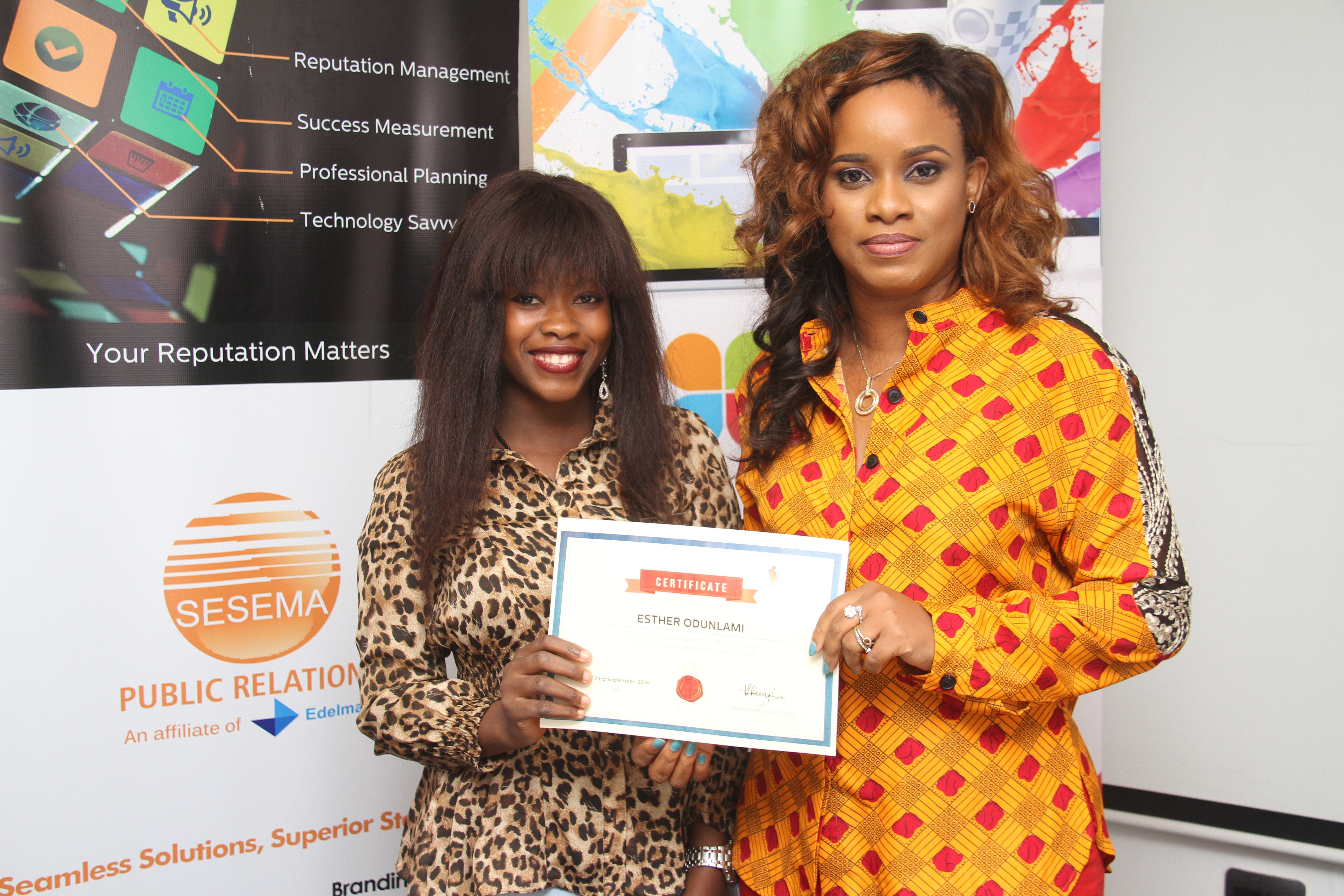 Esther Odunlami receiving her Certificate of participation from the MD Sesema PR, Tampiri Irimagha-Akemu at the Corporate Communications Interactive Forum (CCIF) organised by Sesema PR in Lagos.