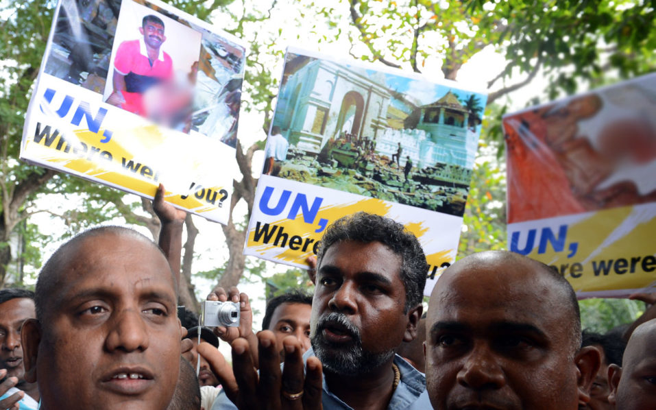 Sri Lankan nationalists, led by Buddhist monks, demonstrate outside the United Nations (UN) compound in the capital Colombo on September 1, 2016. The protest came ahead of a visit to the compound by UN Secretary-General, Ban Ki-moon who is in Sri Lanka on his second visit after the end of the country's ethnic war in May 2009.  / AFP PHOTO / LAKRUWAN WANNIARACHCHI