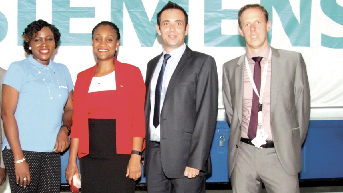 Siemens Country Chief Finance Officer, Funmilayo Akande (left); Managing Director/Chief Executive Officer, Onyeche Tifase, Business Unit Head, Daniel Taylor; Vice President, Region South & West Europe, Africa, Phillip Kurney at the commissioning of the company's service centre in Port Harcourt.