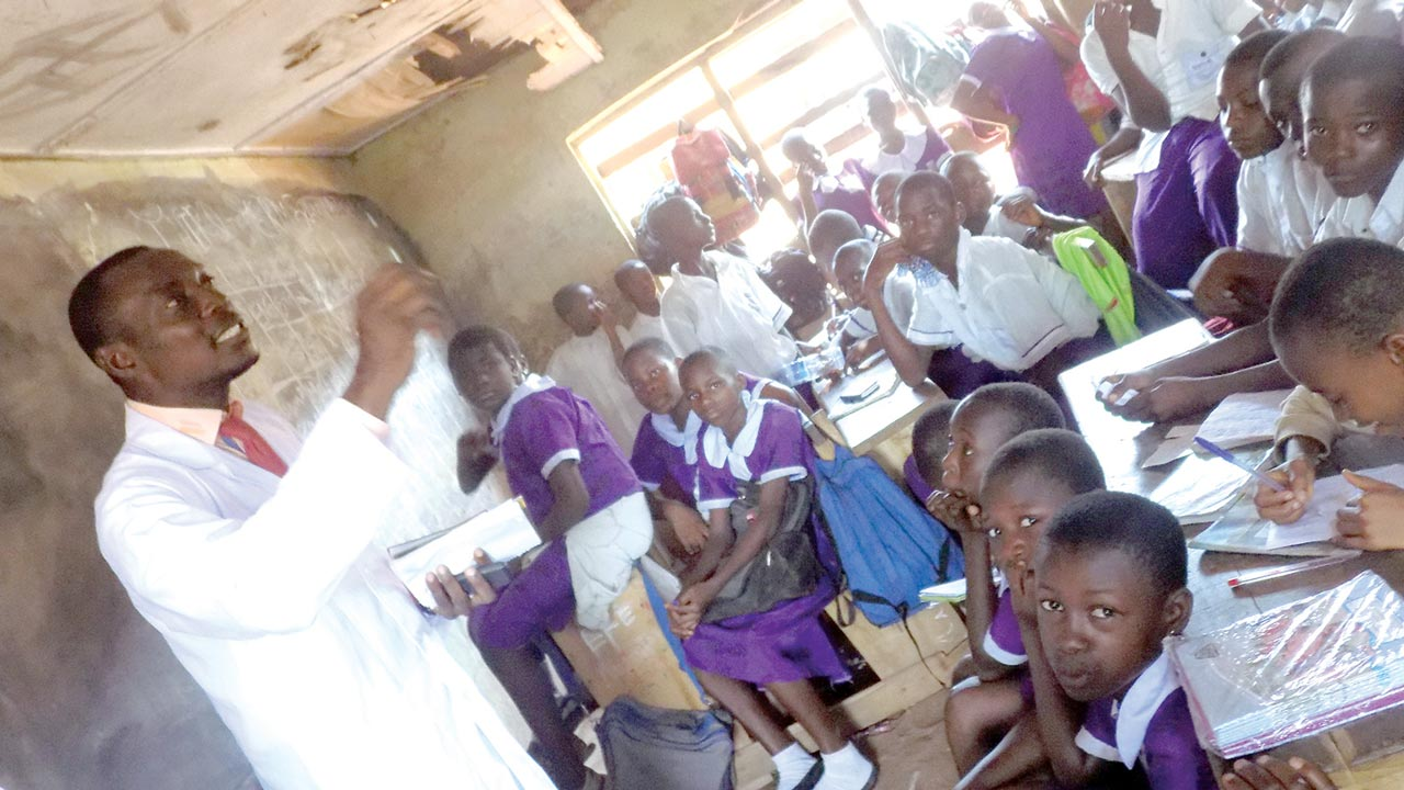 UNIBEN student teaching primary school pupils as part of activities to mark NiMSA week