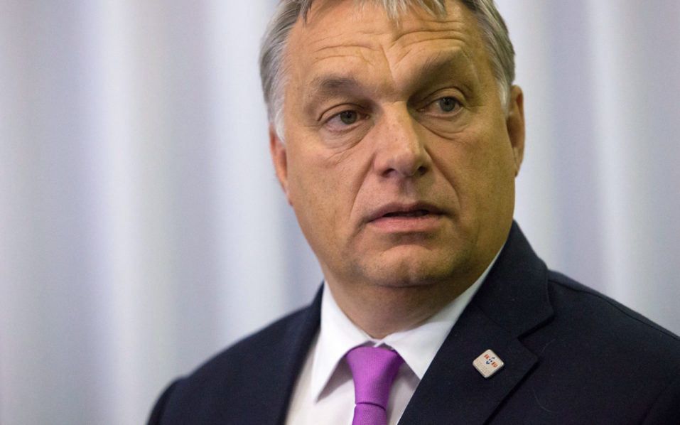 This file photo taken on September 16, 2016 shows Hungarian Prime Minister Viktor Orban arriving for the press conference after European Union Summit of 27 Heads of State or Government in Bratislava, Slovakia. Hungarian Prime Minister Viktor Orban said on September 22, 2016 that migrants who have entered the EU illegally should be deported to camps outside the bloc such as on an island or on the north African coast. / AFP PHOTO / VLADIMIR SIMICEK