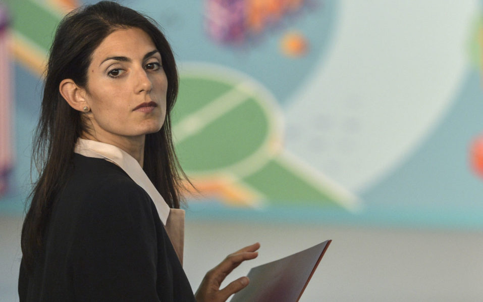 "Rome mayor Virginia Raggi attends the launch of the ""UEFA EURO 2020 ROME"" logo at CONI (Italian Olympic Committee) headquarters in central Rome on September 21, 2016.  / AFP PHOTO / ANDREAS SOLARO"