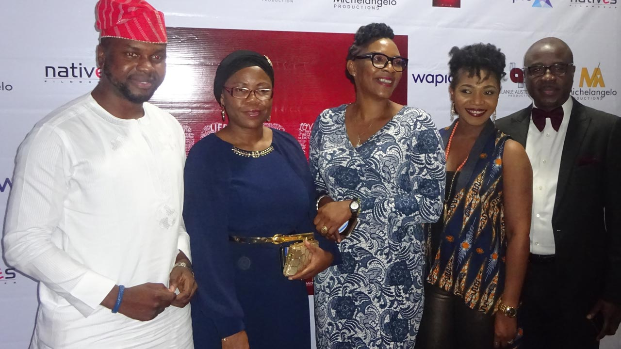 Yinka Adekoya (second left) with some cast members of 93 Days