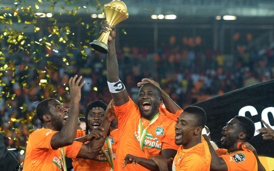 (FILES) This file photo taken on February 10, 2015 shows Ivory Coast's midfielder Yaya Toure (C) raising the trophy at the end of the 2015 African Cup of Nations final football match between Ivory Coast and Ghana in Bata on February 8, 2015. Four-time African footballer of the year Yaya Toure of the Ivory Coast announced his retirement from international football on September 20, 2016. / AFP PHOTO / KHALED DESOUKI