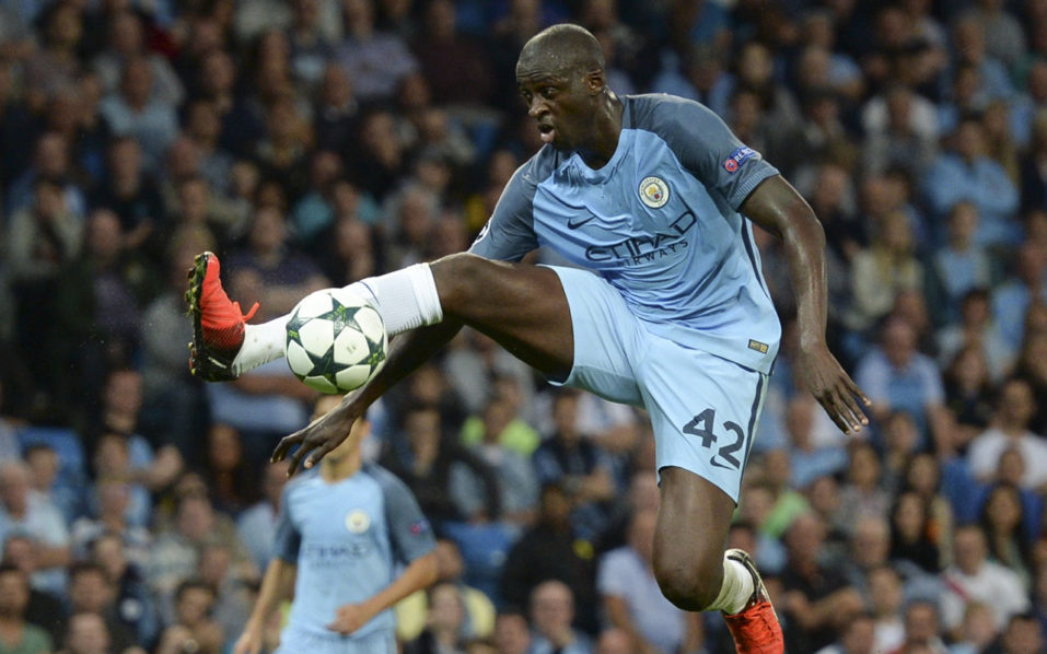 Manchester City's Ivorian midfielder and captain Yaya Toure controls the ball/ AFP PHOTO / OLI SCARFF