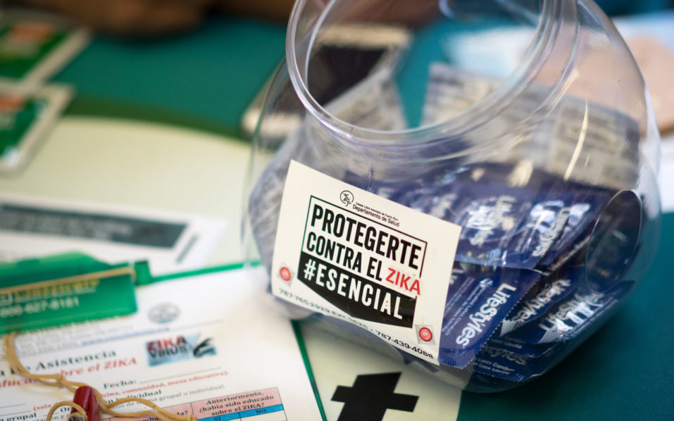 Condoms and literature on the prevention of ZIka and other diseases handed out by health clinic workers during a wellness fair/ Angel Valentin/Getty Images/AFP