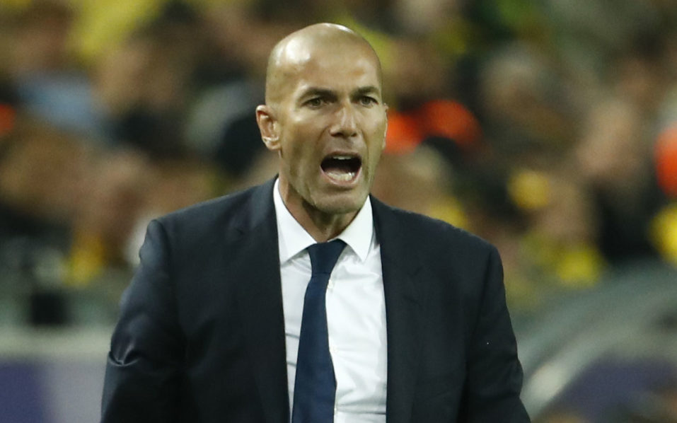 Real Madrid's French coach Zinedine Zidane reacts during the UEFA Champions League first leg football match between Borussia Dortmund and Real Madrid at BVB stadium in Dortmund, on September 27, 2016. / AFP PHOTO / Odd ANDERSEN
