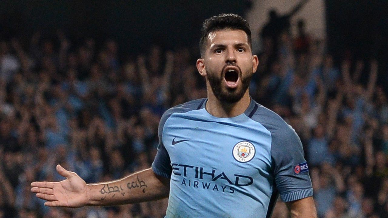 Manchester City's Argentinian striker Sergio Aguero celebrates scoring their third goal and completing his hattrick during the UEFA Champions League group C football match between Manchester City and Borussia Monchengladbach at the Etihad stadium in Manchester, northwest England, on September 14, 2016. OLI SCARFF / AFP